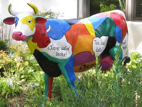 A fiberglass cow painting